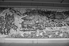 Alter Ziegelstein und japanische Art in der Wand stockfoto