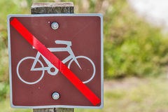 Altered Bicycle Sign. Red tape changes this bicycles welcome sign to one that says no bicycles allowed Royalty Free Stock Image