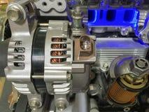 Alternador del coche y corte transversal del filtro de aceite de motor Imagen de archivo libre de regalías