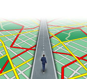 Alternate Route. And leadership solutions with a businessman walking through a complicated road map as a business focus concept of innovative thinking for Stock Images