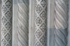 Alternating design on Cement Pillars old bank. A flower motif and a spiral motif adorn these cement pillars that are part of an old bank building in Royalty Free Stock Photos