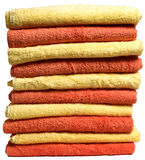 Alternating Stack of Towels. Stack of alternating yellow and orange towels on white background stock photo