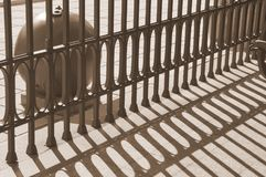 The alternation of light and dark bands in the militar museum. The shadow of the fence. Rhytm of shadows. Royalty Free Stock Image