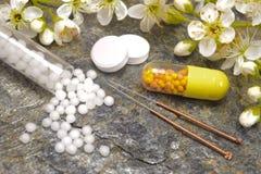 homeopathy och akupunktur royaltyfri bild