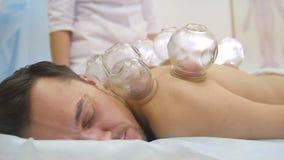Alternative Asian Tibetan medicine, treatment using glass jars, jars placement. Close-up Royalty Free Stock Photos