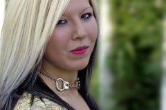 Alternative blonde model with piercing. Smiling Stock Images