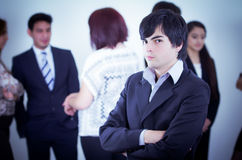 Alternative business man in front of a group Royalty Free Stock Images