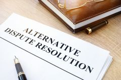 Alternative dispute resolution ADR in an office. Documents with title alternative dispute resolution ADR in an office royalty free stock images