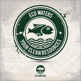 Alternative eco waters stamp. Containing: two variations of environmentally sound eco motifs, grunge ink rubber stamp effect, textured watercolor carton paper Royalty Free Stock Images