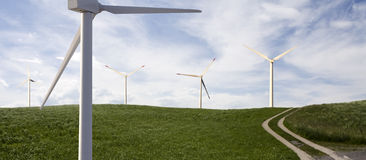 Alternative energies. Concept wind wind generator, solar cell Royalty Free Stock Image