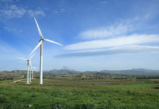 Alternative energy. Windmills and farm fields in Trapani countryside - Sicily Stock Image