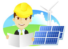 Alternative energy. Mid adult male engineer holding blueprints in solar power station with a wind turbine Royalty Free Stock Image