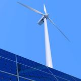 Alternative energy. Solar panel and wind turbine on blue background Stock Image