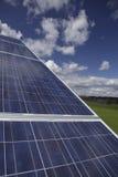 Alternative energy. Array of alternative energy photovoltaic solar panels on roof Royalty Free Stock Photography