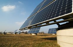 Alternative energy. Field of different solar panels as a small power station (sRGB Royalty Free Stock Images