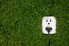 Alternative energy. Energy concept outllet in grass Stock Images