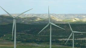 Alternative energy generation, nature conservation. Wind turbines, green hills. Stock footage stock video footage