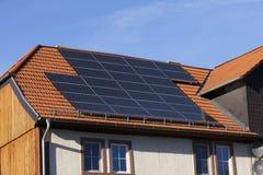 Alternative energy photovoltaic solar panels. Solar power photovoltaic energy panels on tiled house roof Royalty Free Stock Photo