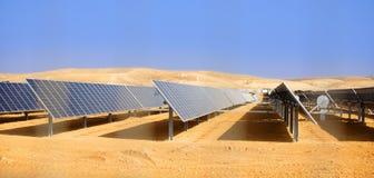 Alternative energy, solar batteries in the desert. Alternative energy, industrial landscape solar batteries in the desert stock images