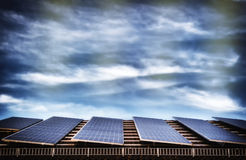 Alternative energy with solar panel system. On house roof top stock images