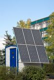 Alternative energy sources. Solar battery for reception of energy in the city Stock Photo