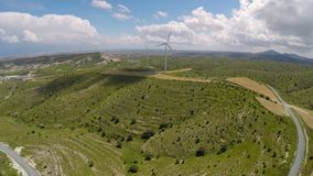 Alternative energy sources at Mediterranean, bird's-eye view of wind turbines. Stock footage stock footage