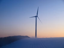 Alternative energy wind mills in the snow Stock Photos