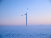 Alternative energy wind mills in the snow Stock Images