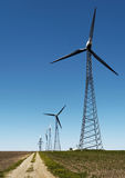 Alternative Energy - Wind resources. Wind turbines against a clear blue sky royalty free stock photos