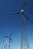 Alternative Energy - Wind turbines. Wind turbines against a clear blue sky stock images