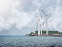 Alternative Energy Wind Turbines on Water. Wind Turbines are creating alternative energy on a water shore for a clean environment concept Stock Images
