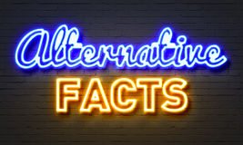 Alternative facts neon sign on brick wall background. Alternative facts neon sign on brick wall background royalty free stock photos
