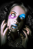 Alternative fashion model face. Bright makeup Stock Photography