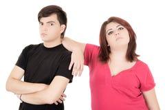 Alternative fighting couple on white background Stock Image