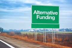 Alternative funding on road sign, entrepreneurship and business Stock Photo
