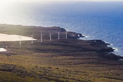 Wind power plant on the ocean shore. Alternative green energy for a better world. Wind power plant on the ocean shore. Sustainable power for the growing demands royalty free stock photography