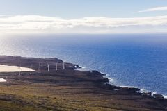 Wind power plant on the ocean shore. Alternative green energy for a better world. Wind power plant on the ocean shore. Sustainable power for the growing demands stock photography