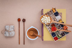 Alternative health care dried various Chinese herbs in wooden bo Royalty Free Stock Image