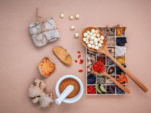 Alternative health care dried various Chinese herbs in wooden bo Royalty Free Stock Photography