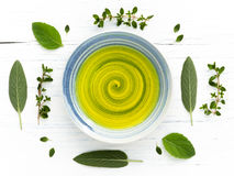 Alternative health care fresh herbal and fragrant oil in  a bowl Royalty Free Stock Photo