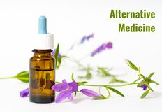 Alternative medicine. Concept with bottle and flower royalty free stock photos