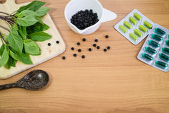 Alternative medicine, blisters of capsules herbal pills, tablets Stock Photo