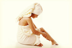 Alternative medicine and body treatment concept. Atractive  young woman after shower with towel. Stock Photos