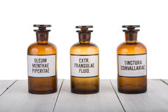 Alternative medicine bottels with mint oil Royalty Free Stock Photography