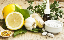 Alternative Medicine with Garlic, Ginger and Lemon Oil Royalty Free Stock Photos