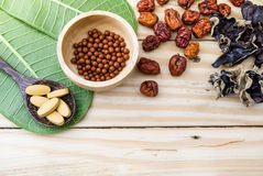 Alternative medicine,  herbs, herbal pills, tablets on wood back Royalty Free Stock Photography