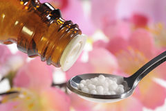 Alternative medicine with homeopathic pills Stock Image