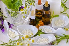 Free Alternative Medicine. Homeopathy. Homeopathic Globules And Essen Stock Image - 121391771