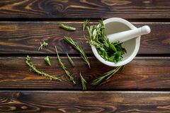 Alternative medicine with medicinal herbs on wooden background top view.  royalty free stock photography