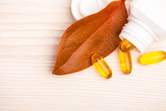 Alternative medicine with orange leaf and white container Stock Photography